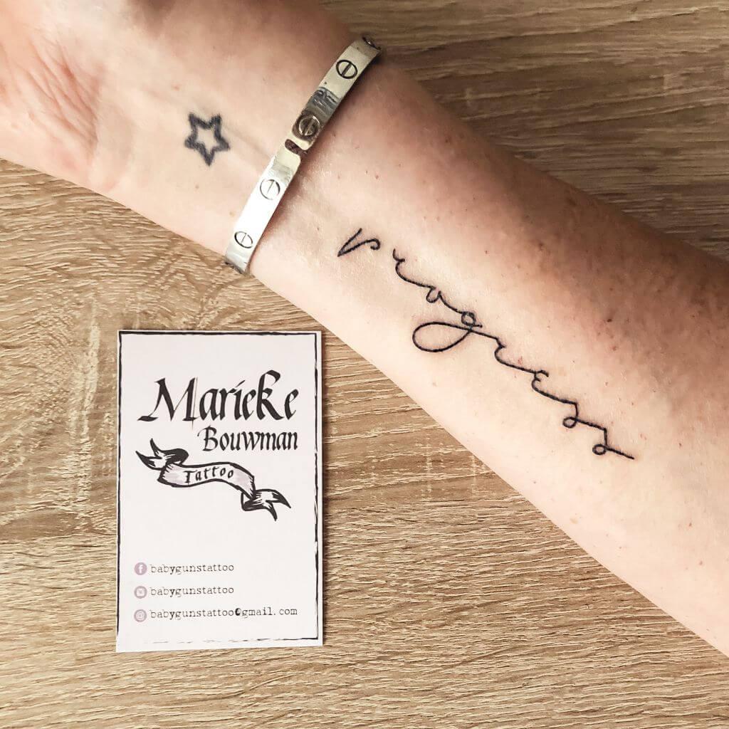'Progress' tattoo